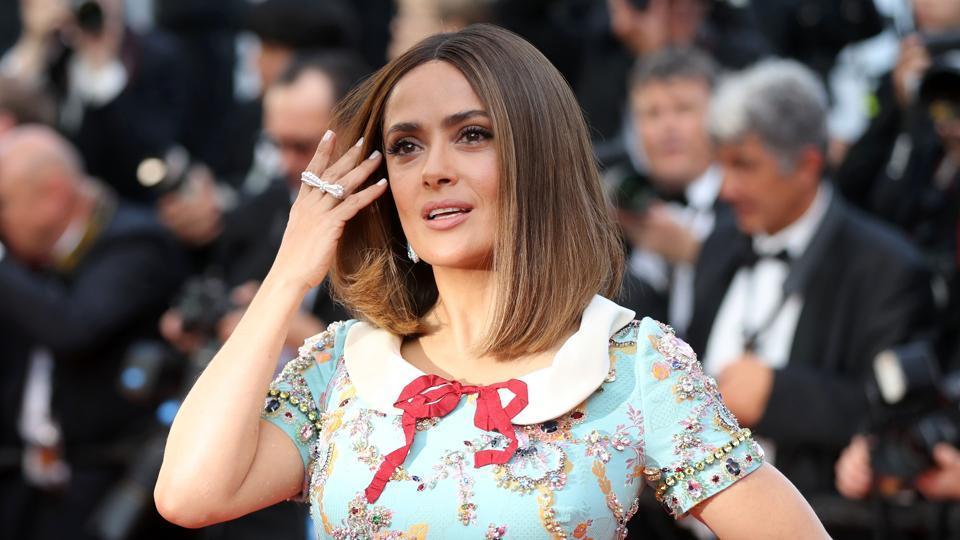 Salma Hayek poses as she arrives on May 23, 2017, for the '70th Anniversary' ceremony of the Cannes Film Festival in Cannes.