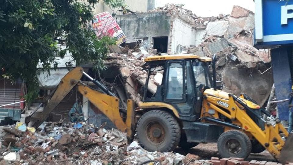 Debris of the collapsed building are being cleared in East Delhi's Laxmi Nagar.
