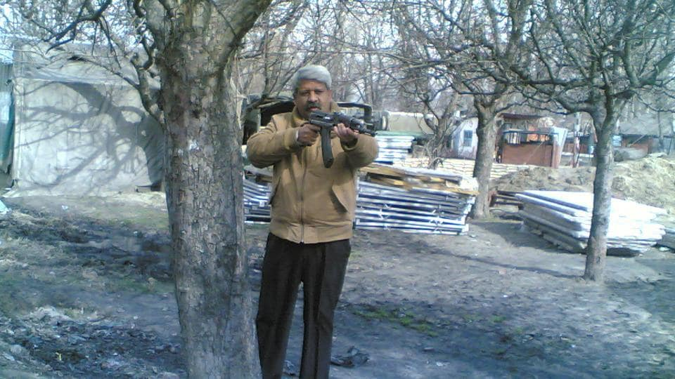 Military intelligence operatives work in civil clothes but are always alert to attacks. Colonel Bipin Pathak armed with an assault rifle ready to carry out a raid, somewhere in Kashmir, circa early 2000s.