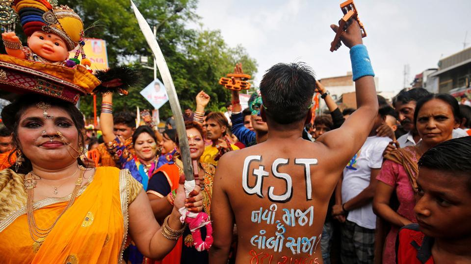 A Hindu devotee shows his painted back with a message reading 'GST (Global Service Tax) - A new boon or a lasting burden?' ahead of the roll-out of the new tax in India, during the annual Rath Yatra or chariot procession, in Ahmedabad. (Amit Dave / Reuters)