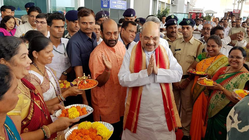 BJP president Amit Shah being welcomed upon his arrival at Dabolim airport in Goa on Saturday.