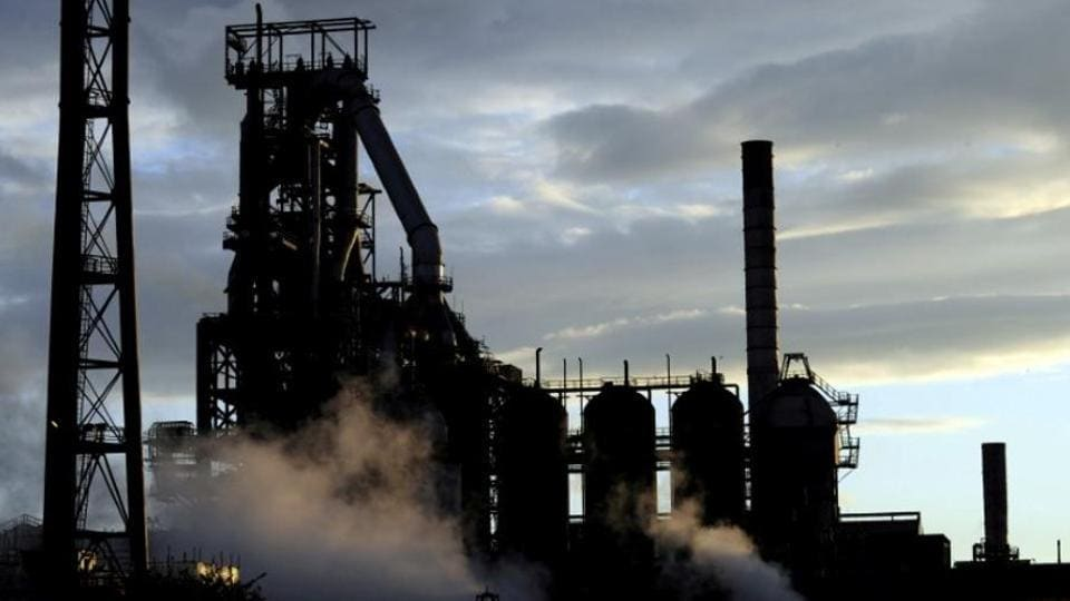 One of the blast furnaces of the Tata Steel plant is seen at sunset in Port Talbot, South Wales, May 31, 2013.