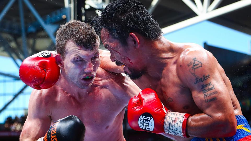 Manny Pacquiao (R) of the Philippines fight Jeff Horn (L) of Australia during the World Boxing Organization bout.