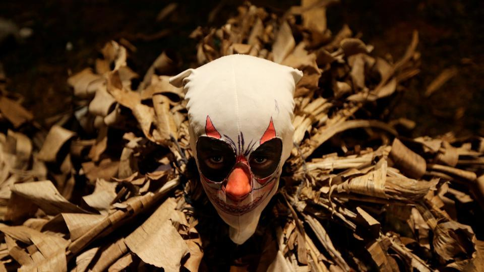 A youth disguised as a Guaikuru takes part in the Kamba Ra'Anga celebration, which originated during colonial times and is based on Spanish, Indigenous and African customs, in Altos, Paraguay. (Jorge Adorno / Reuters)