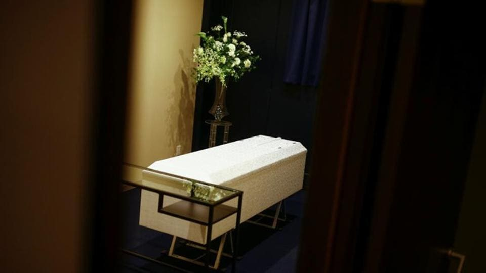 A coffin awaiting departure to the crematorium at Hotel Sousou,  a corpse hotel in Kawasaki City, Japan.