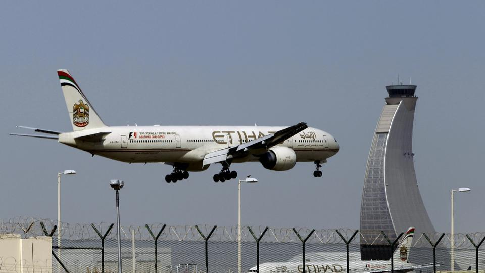 In this file photo, an Etihad Airways plane prepares to land at the Abu Dhabi airport in the United Arab Emirates.