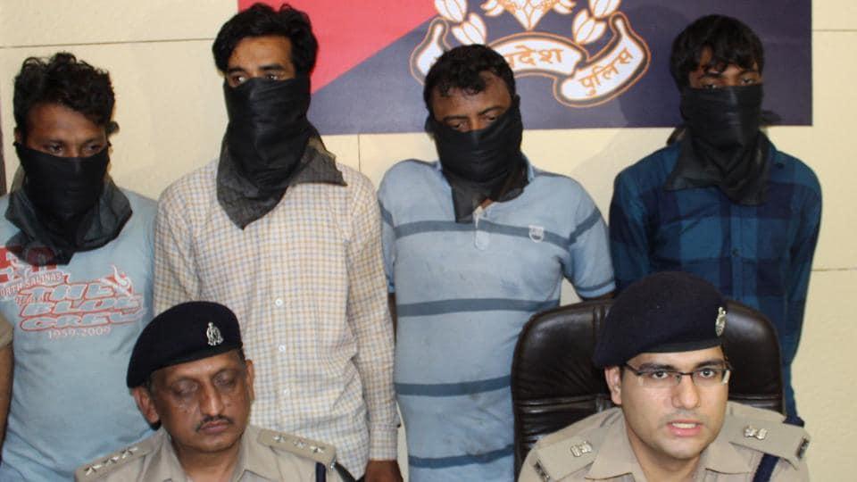 The arrested men in police custody.