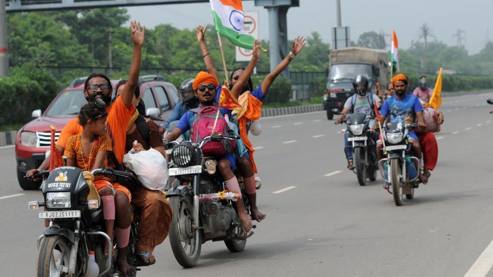 Kanwariyas run after collecting holy water from Ganga in Haridwar.