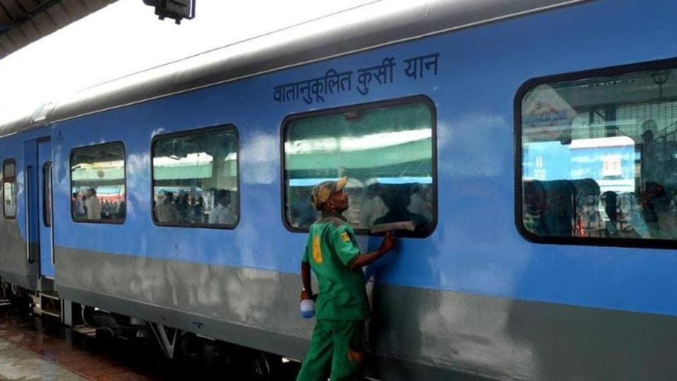 An Indian Railways worker cleans a coach at the New Delhi railway station.