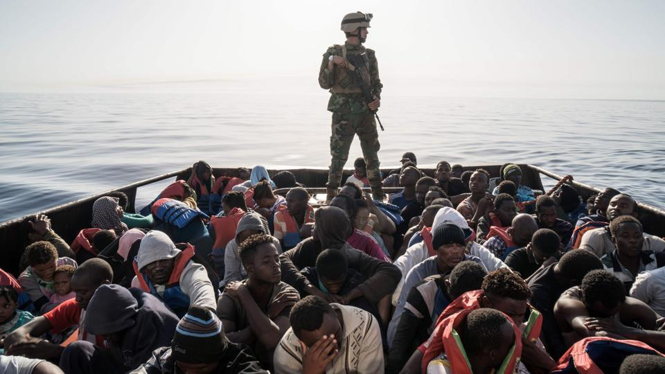 A Libyan coast guardsman stands on a boat during the rescue of 147 illegal immigrants attempting to reach Europe off the coastal town of Zawiyah, 45 kilometres west of the capital Tripoli, Libya. (Taha Jawashi / AFP)