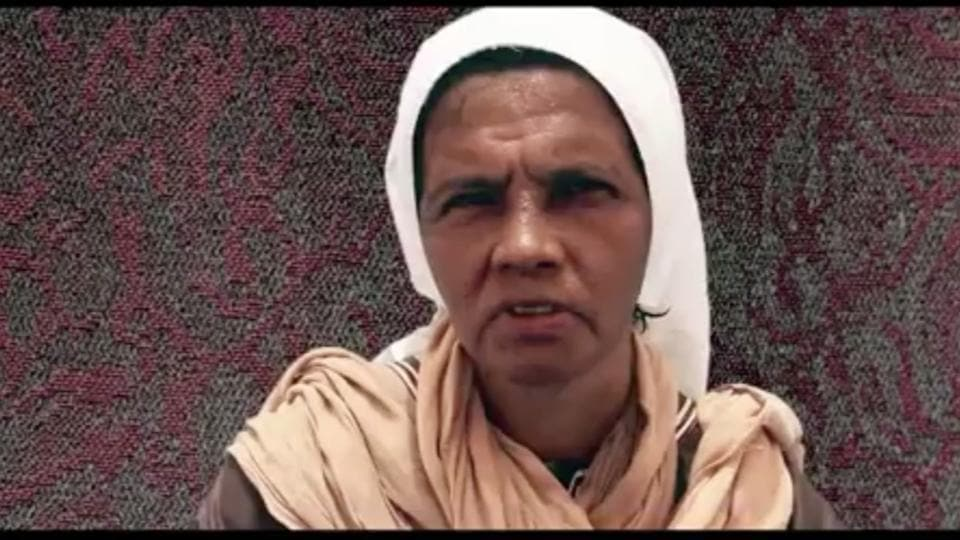 This undated frame grab from video, posted online by recently formed militant group Nusrat al-Islam wal Muslimeen, shows hostage Gloria Cecilia Narvaez of Colombia in an unknown location, with a caption reading in Arabic 'My name is Gloria Cecilia Narvaez'.