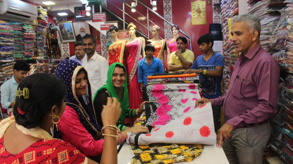Shoppers but garments at Sadar Bazaar in Gurgaon after implementation of GST on July 1.