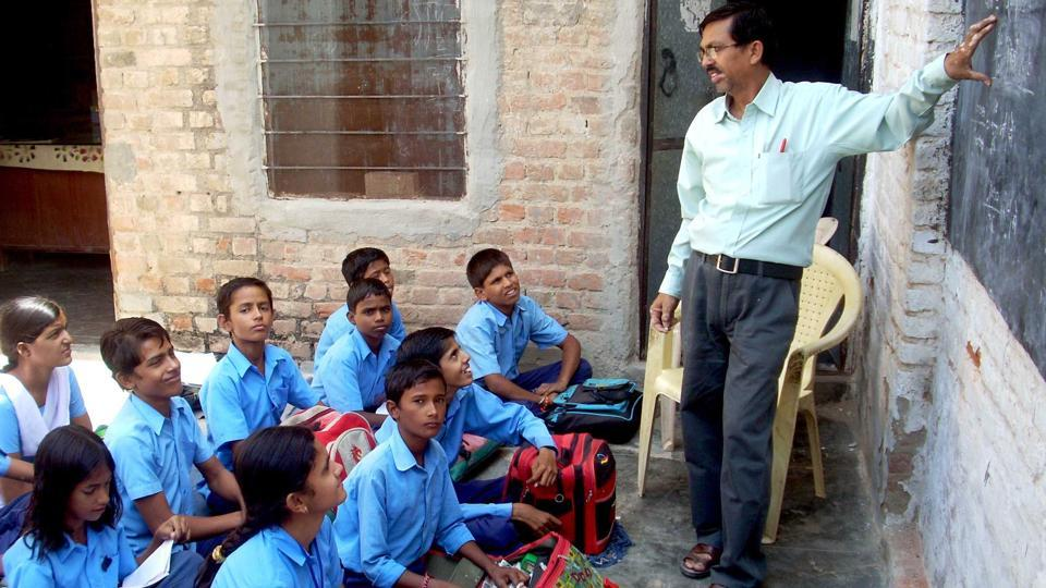 Students of government secondary school study in a class in western Rajasthan.