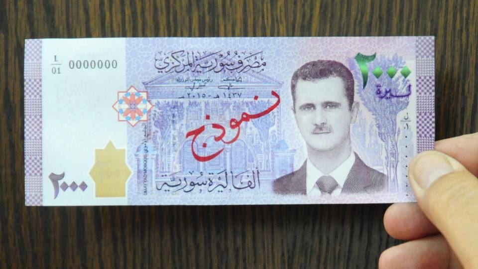 A photo released by Syrian official news agency SANA, shows a new bank note of 2,000 Syrian Lira that feature the face of President Bashar Assad.