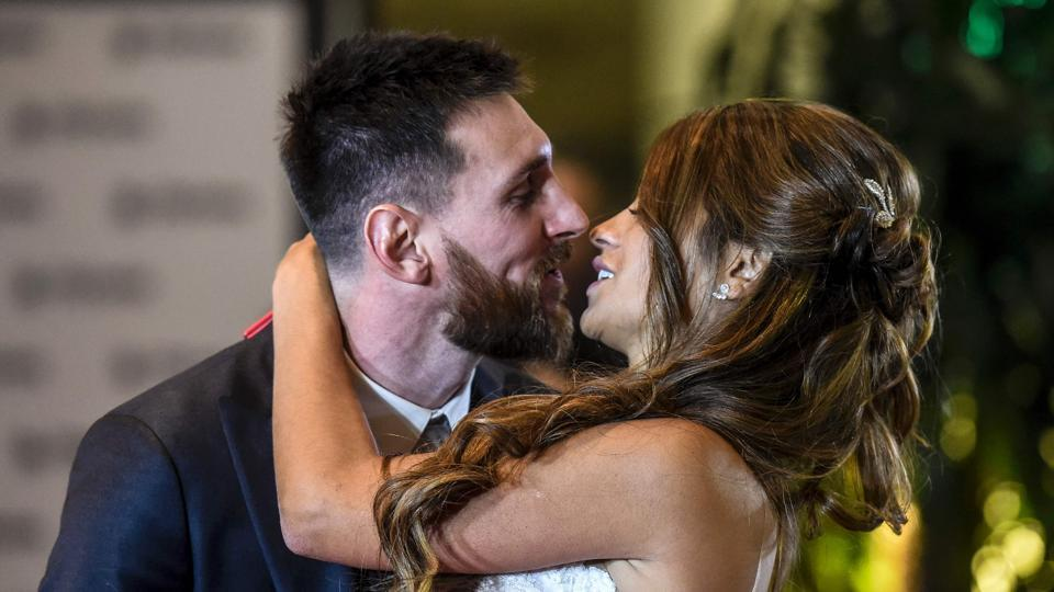 TOPSHOT - Argentine football star Lionel Messi and bride Antonella Roccuzzo pose for photographers during their wedding at the City Centre Complex in Rosario, Santa Fe province, Argentina. Footballers and celebrities including pop singer Shakira gathered Friday for the