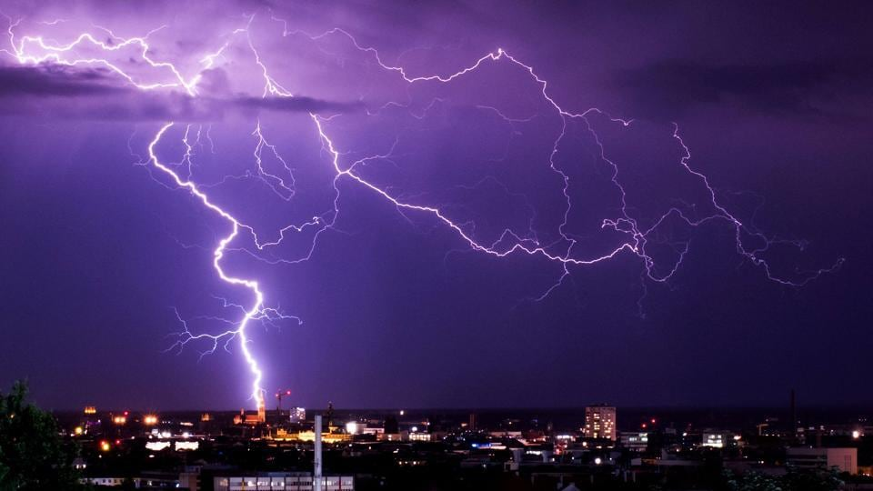 Lightning flashes over the cityscape in Munich, Germany. (Marcel Kusch / AFP)