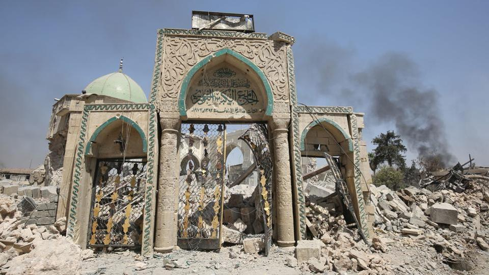 A view of the destroyed gate of the Al-Nuri Mosque in the Old City of Mosul, as Iraqi government forces continue their offensive to retake the city from Islamic State (IS) group . IS blew up the mosque and the famed Al-Hadba (hunchback) leaning minaret on June 21 as Iraqi forces closed in. (Ahmad Al Rubaye / AFP)