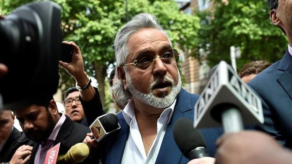 Force India co-owner, Vijay Mallya, talks outside Westminster Magistrates, in central London.