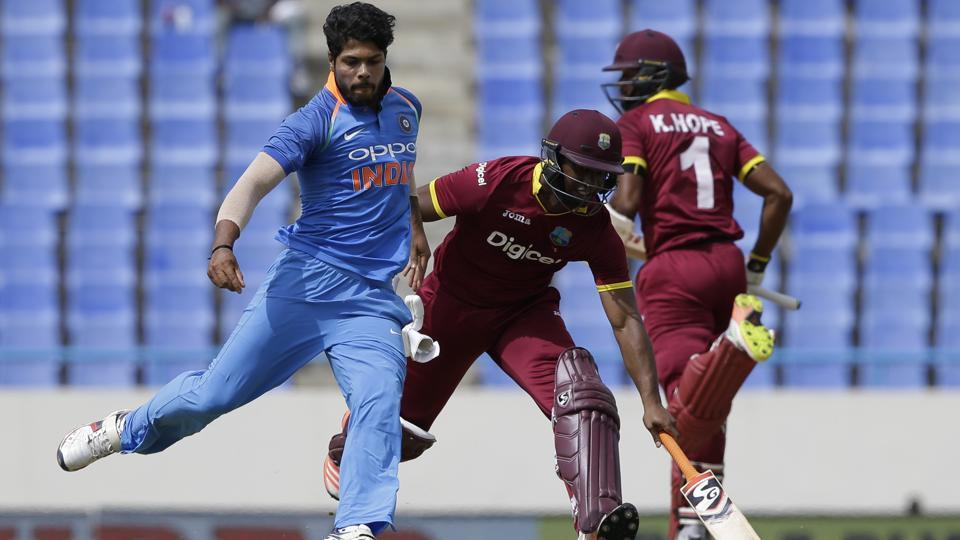 India's bowler Umesh Yadav tries to kick the ball in an unsuccessful attempt to ran out West Indies' Evin Lewis. (AP)