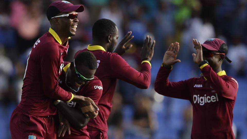 West Indies layers celebrate the dismissal of India's MS Dhoni during their fourth ODI cricket match. (AP)