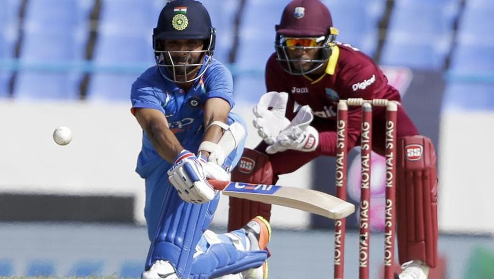 India's Ajinka Rahane plays a shot to be caught by West Indies' wicket keeper Shai Hope during their fourth ODI cricket match.