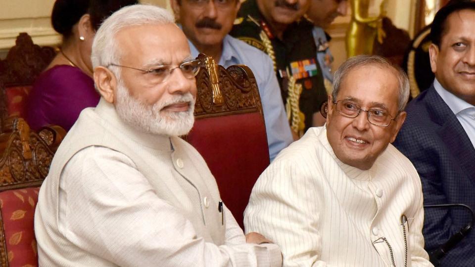 "New Delhi: President, Pranab Mukherjee and the Prime Minister,Narendra Modi at the ceremony to release a photo book titled ""President Pranab Mukherjee - A Statesman"", at Rashtrapati Bhawan, in New Delhi on Sunday."