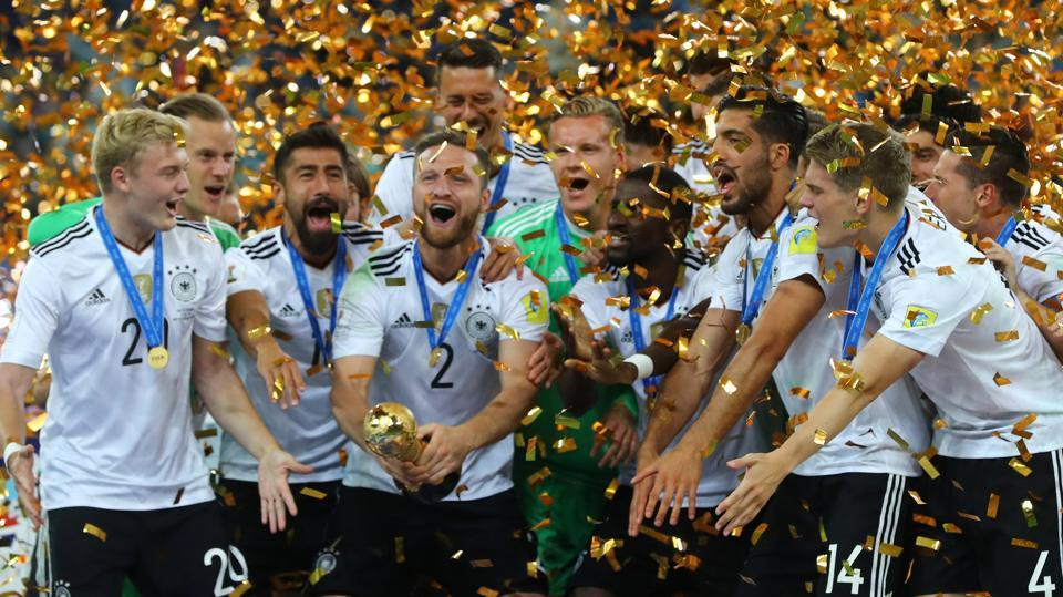 Germany playerscelebrate with the trophy after winning the FIFA Confederations Cup final 1-0 against Chile at the Saint Petersburg Stadium on Sunday.