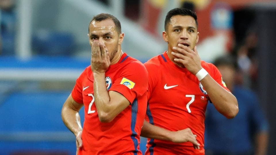 Chile's Alexis Sanchez and Marcelo Diaz (left) react after their team's defeat in the Confederations Cup final against Germany.