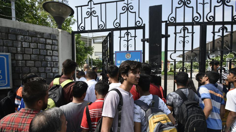 Around eight applicants were stopped from giving the exam after they tried to sneak in mobile phones to the exam hall, an official from the exam department said.