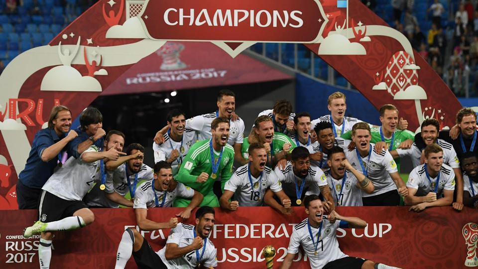 Germany's players pose with the trophy after winning the 2017 Confederations Cup final against Chile.