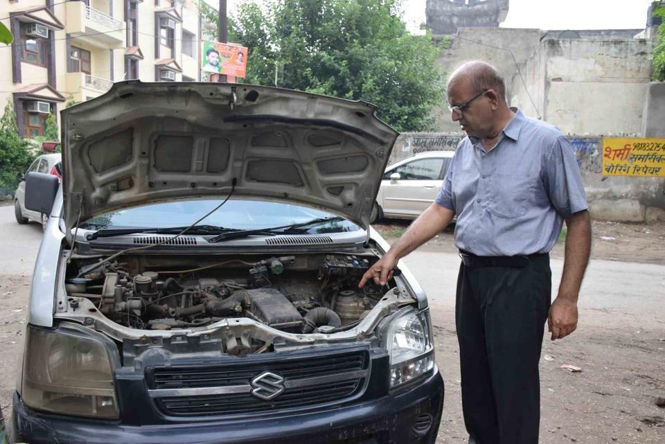 A Vaishali resident with one of the cars from which the battery was stolen on Sunday night.