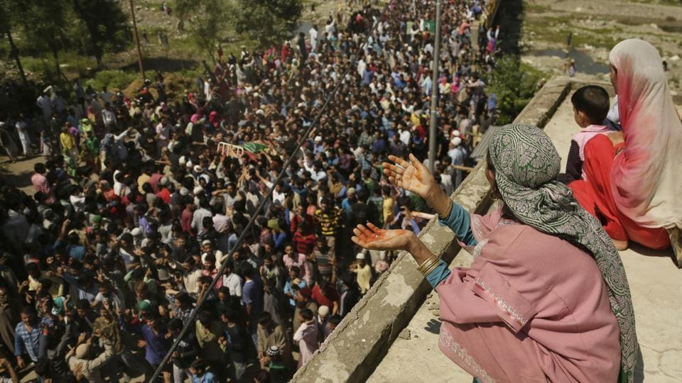 A Kashmiri woman prays as villagers carry the body of Bashir Lashkari, a local rebel commander, during his funeral in his native village of Souf, 75 kilometres (46 miles) south of Srinagar.