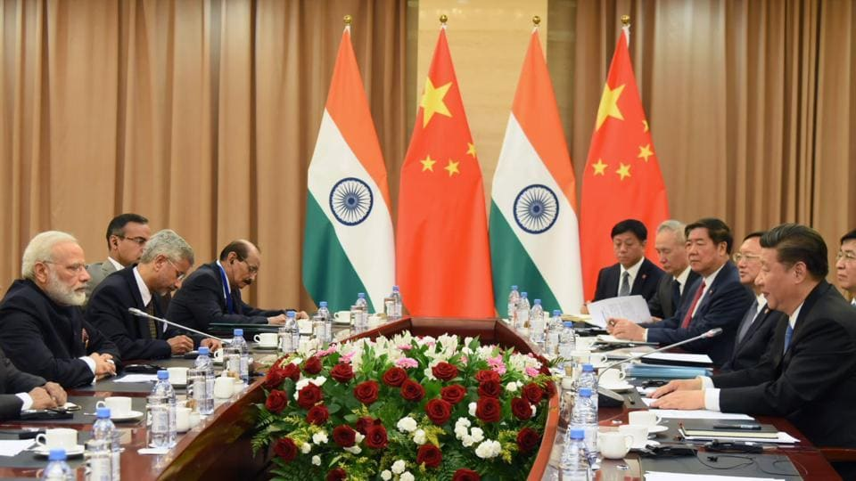 Prime Minister Narendra Modi and Chinese President Xi Jinping take part in a meeting on the sidelines of the Shanghai Cooperation Organisation (SCO) Summit in Kazakhstan.