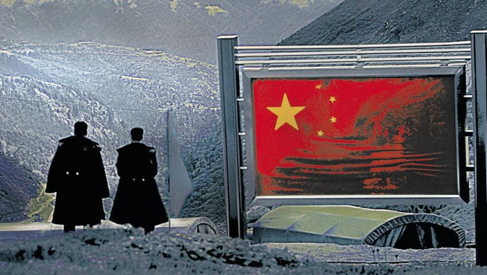 Chinese army officers oversee preparations as they stand on the international border at Sikkim.