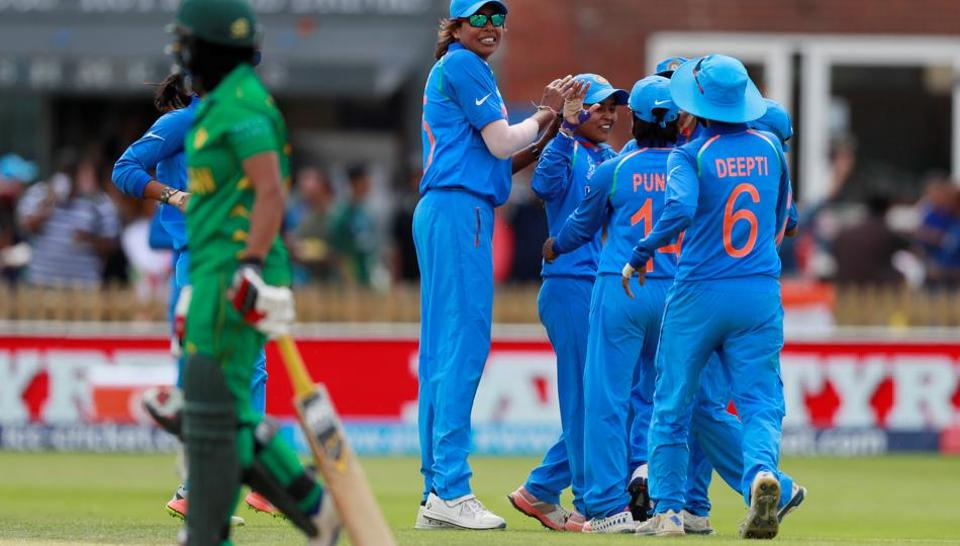 India's Ekta Bisht celebrates taking the wicket of Pakistan's Iram Javed with teammates during an ICC Women's World Cup match.