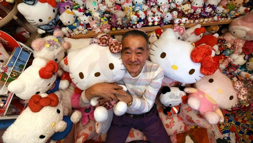 Retired Japanese police officer Masao Gunji with his Hello Kitty collection at his pink-painted Hello Kitty house in Yotsukaido, Chiba prefecture in Japan.