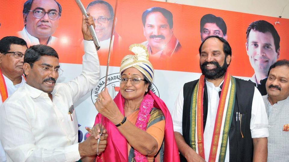 Presidential candidate Meira Kumar holds a sword presented to her by Congress leaders at a meeting in Hyderabad on Monday.