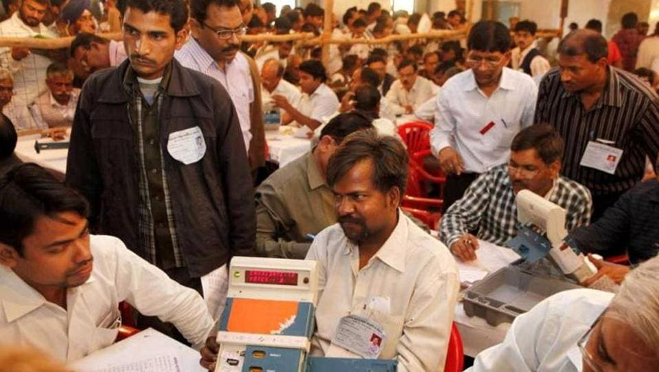 An election official during counting of votes for the assembly election in Uttar Pradesh.