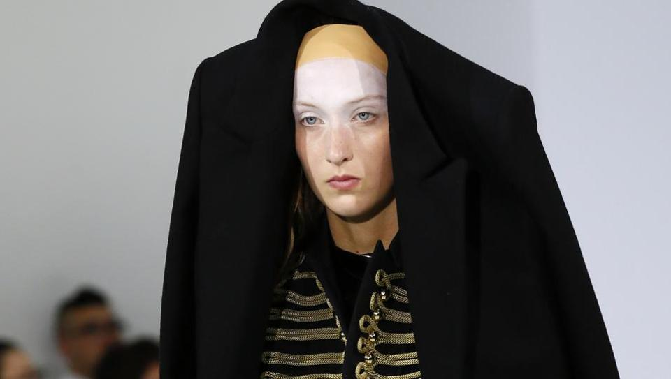 Belgian fashion designers An Vandevorst and Filip Arickx, turned black plastic bin liners and dry cleaning sheaths into clothes.