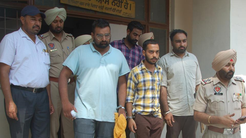 Main accused (sky blue t-shirt and check shirt) of Paras murder case coming out district court in Patiala on Monday.