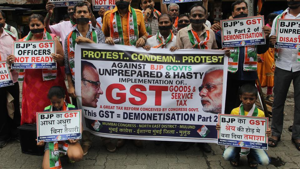 Congress workers protest against the Centre over GST in Mumbai on Sunday.