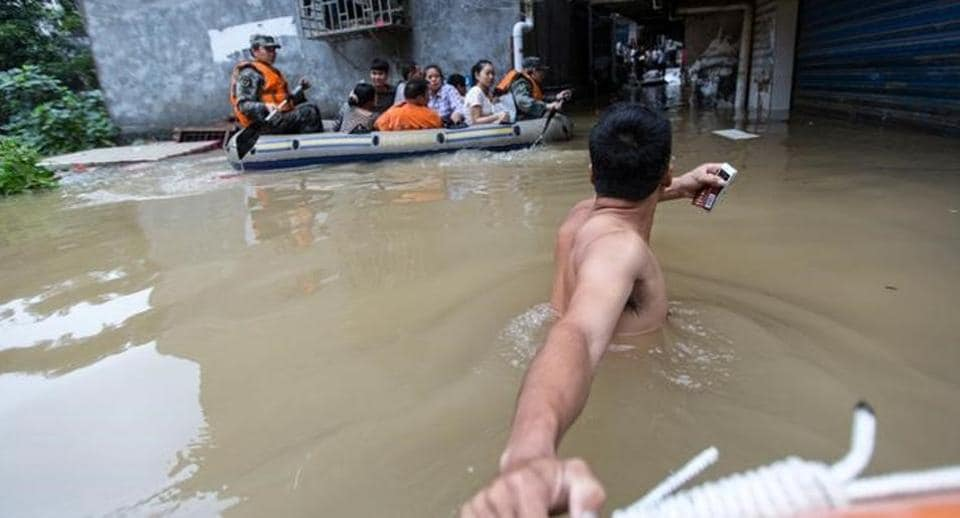 Rescuers row as they transfer residents with a boat at a flooded area in Guilin, Guangxi province, China on July 2.