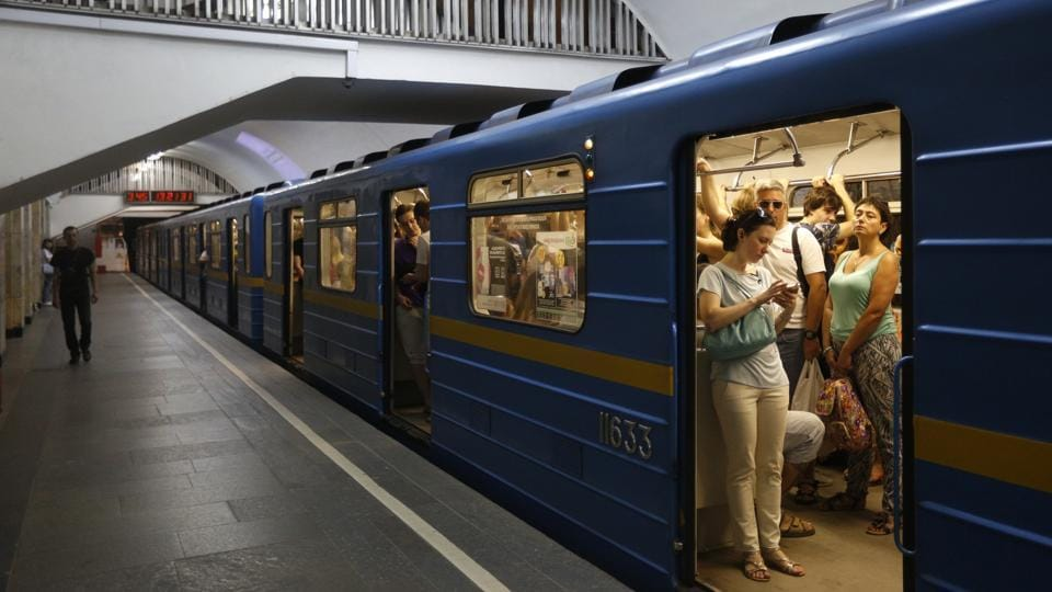 Passengers use mobile phones in an underground in Kiev, Ukraine on June 28, 2017. The latest cyberattack ransomware that paralysed computers across the world hit Ukraine the hardest  with victims including top-level government offices and energy companies.