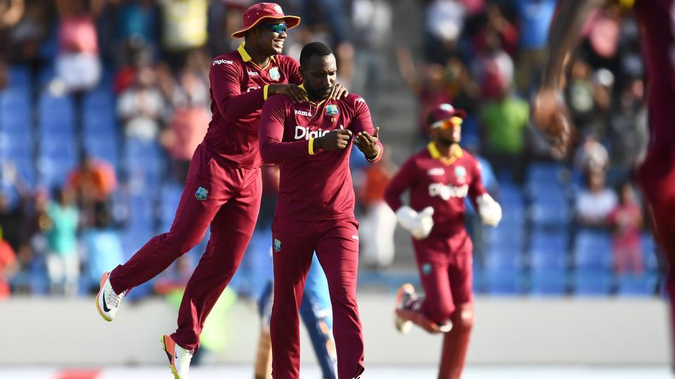 West Indies' Kesrick Williams (C) celebrates with teammates after dismissing India's MS Dhoni. (AFP)