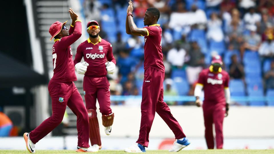 West Indies' Alzarri Joseph (R) celebrates with teammates after dismissing India's Shikhar Dhawan. (AFP)