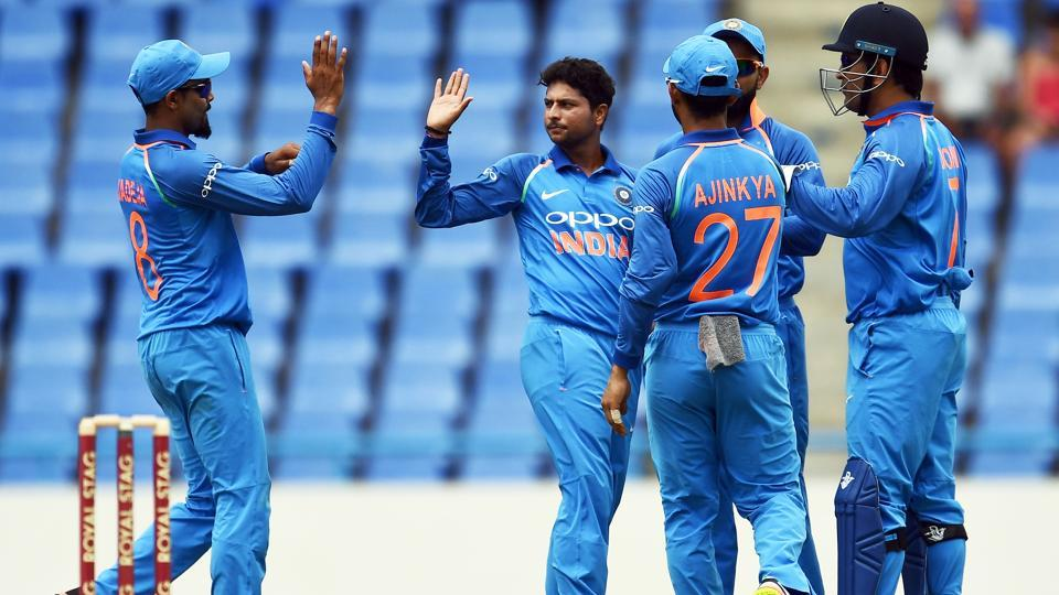 India's Kuldeep Yadav (C) celebrates with teammates after dismissing West Indies' Evin Lewis. (AFP)