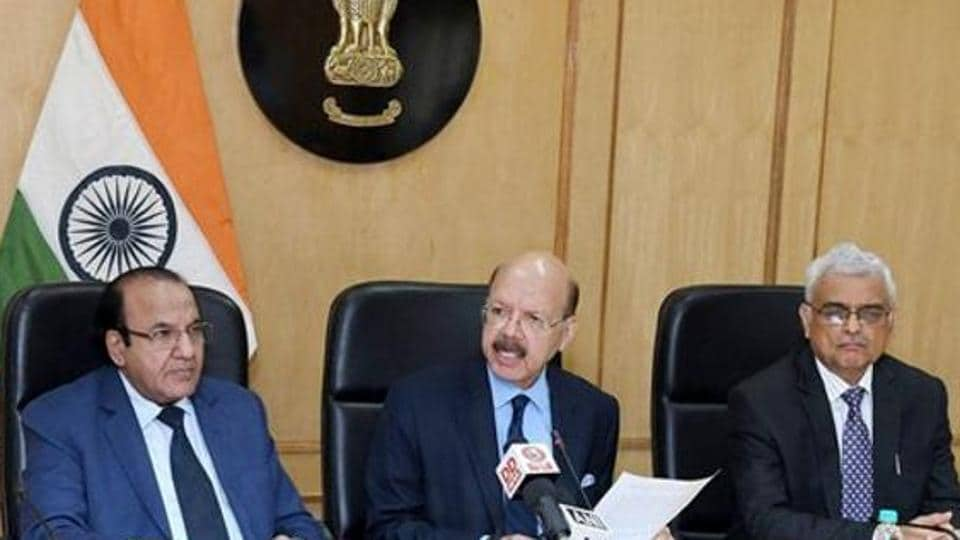 Outgoing chief election commissioner Nasim Zaidi (C), along with election commissioners Achal Kumar Joti (L) and OP Rawat during a press conference.
