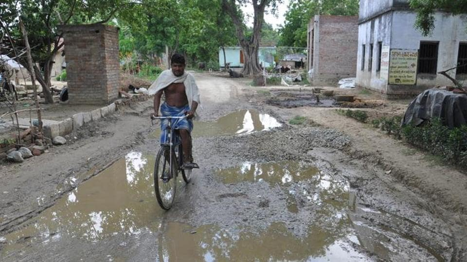 A dilapidated road filled with potholes connects Kakrahia with Varanasi
