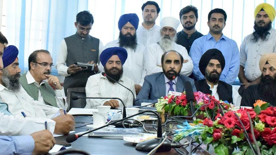 Pakistan Sikh Gurdwara Parbandhak Committee and Evacuee Trust Property Board officials talk to the media in Lahore.