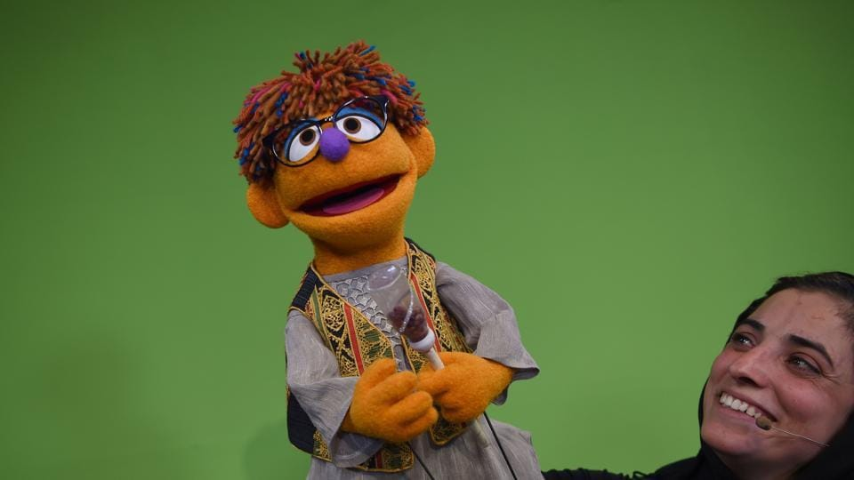 Afghan puppeteers Seema Sultani holds the new Sesame Street Muppet Zeerak during a recording at a television studio in Kabul.